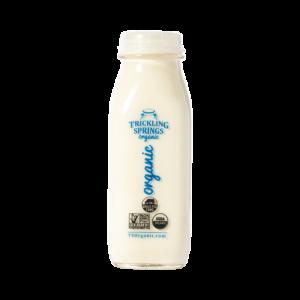 Trickling Springs Organic Heavy Cream in a glass pint bottle